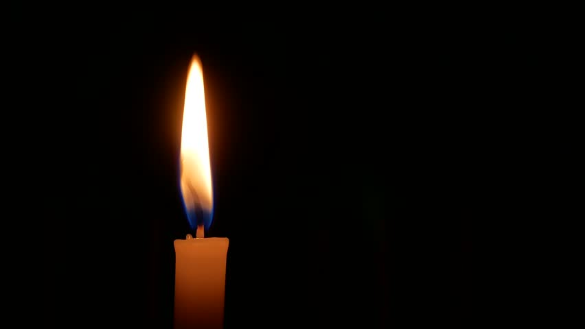 Close-up of candle flame in black background.
