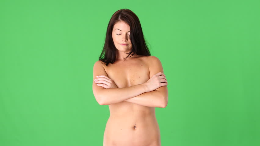 Naked woman covering breasts