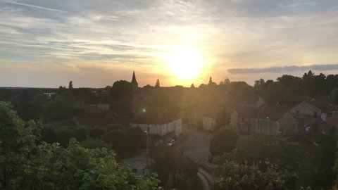 Panoramic timelapse sunset view over Chateau Gerard, a cozy small village in Burgundy (Bourgogne), France