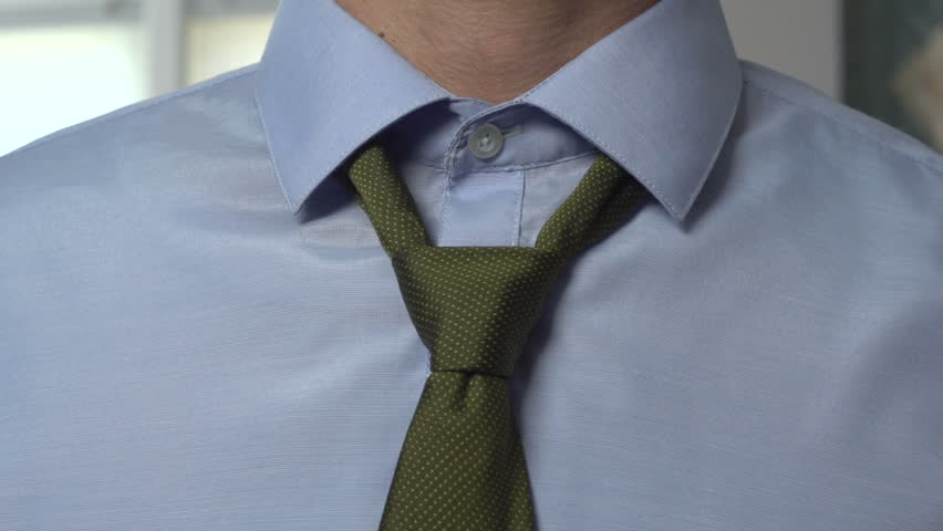Man tying necktie, close up