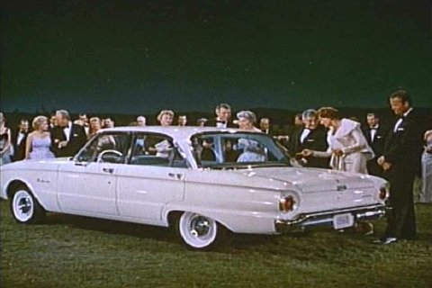 1960s: Three new models of Fords are shown to party guests, backed by a choir in 1960.