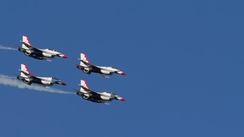 TITUSVILLE, FLORIDA - CIRCA MARCH 2017: USAF Thunderbirds Demonstration Team performs at airshow - four jets flying past camera in very tight formation in super slow motion