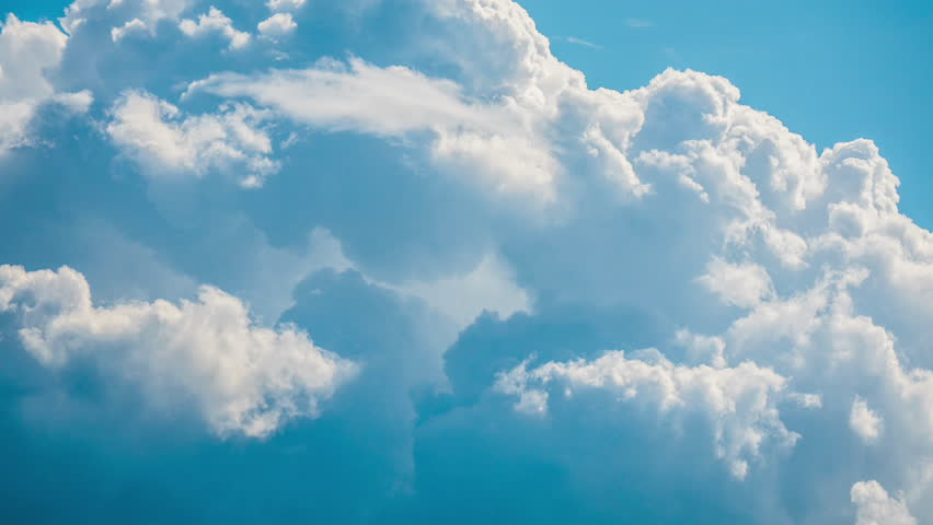 White clouds flying blue sky time lapse. Cumulus clouds fast flying sky timelapse. Abstract clouds flying, moving, running, rolling, morphing sky. Clouds flying, moving heavenly sky video footage 4K