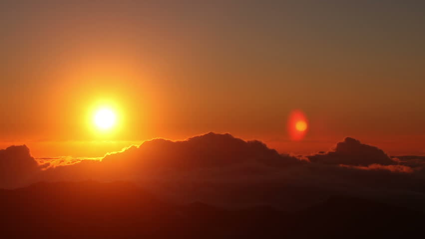 Red sun disk time lapse dawn with flowing cloud waves HDR, shot at Haleakala National Park, Hawaii | Shutterstock Video #2786668