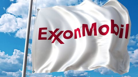 Waving flag with Exxon Mobil logo against moving clouds. 4K editorial animation