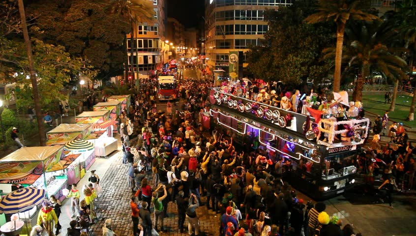 LAS PALMAS DE GRAN CANARIA, SPAIN - FEBRUARY 18: 200,000 masked revelers and a hundred or so festooned cars and floats in the Grande Parade (Gran Cabalgata ) of the Carnival February 18, 2012, Spain