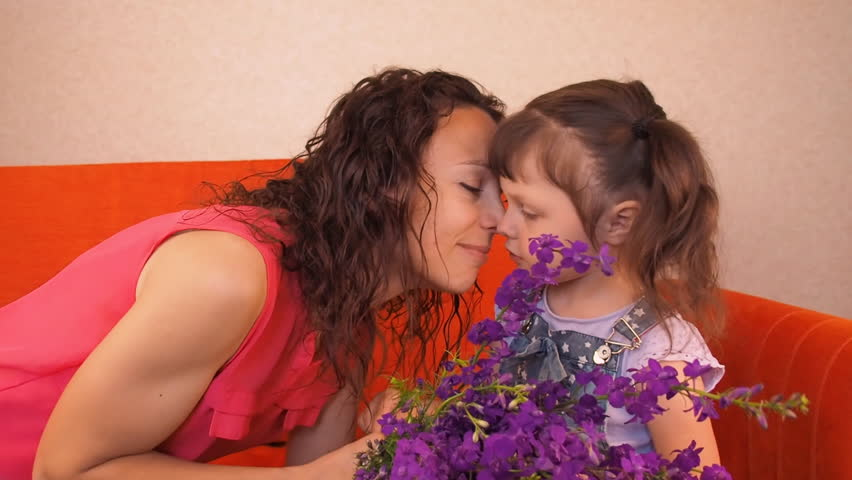 Mom and daughter rub their noses. Emotions of a happy family. | Shutterstock HD Video #27914947