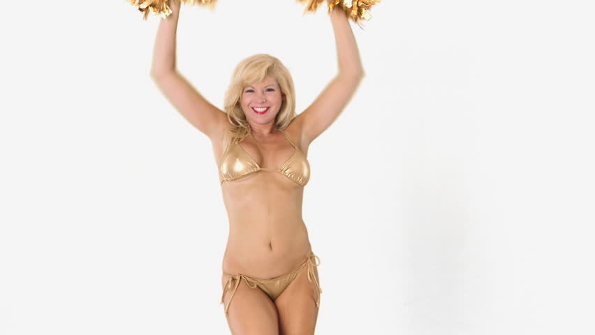 Sexy blond girl in gold bikini cheering with pom poms