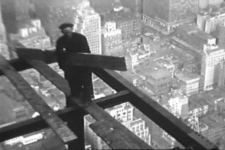 1930s: Construction workers erect the world\x90s tallest building in New York City in the 1930s