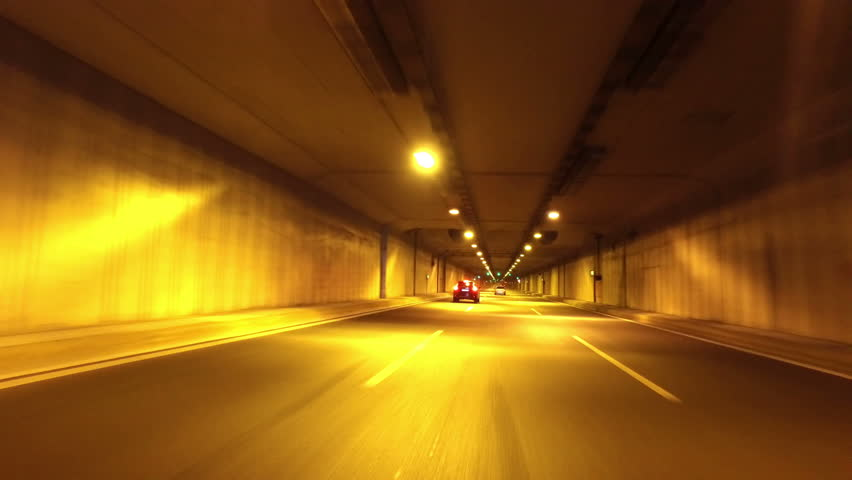 The car goes through a tunnel and exit it | Shutterstock HD Video #28035754