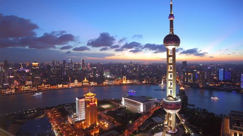 """Shanghai, China - CIRCA JULY 2012:  Time lapse of Shanghai Skyline and Oriental Pearl Tower at dusk.  >>> Please search similar: """" ShanghaiSkyline """" ."""