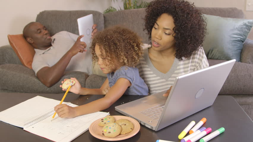 African American family doing homework with laptop | Shutterstock HD Video #2806474