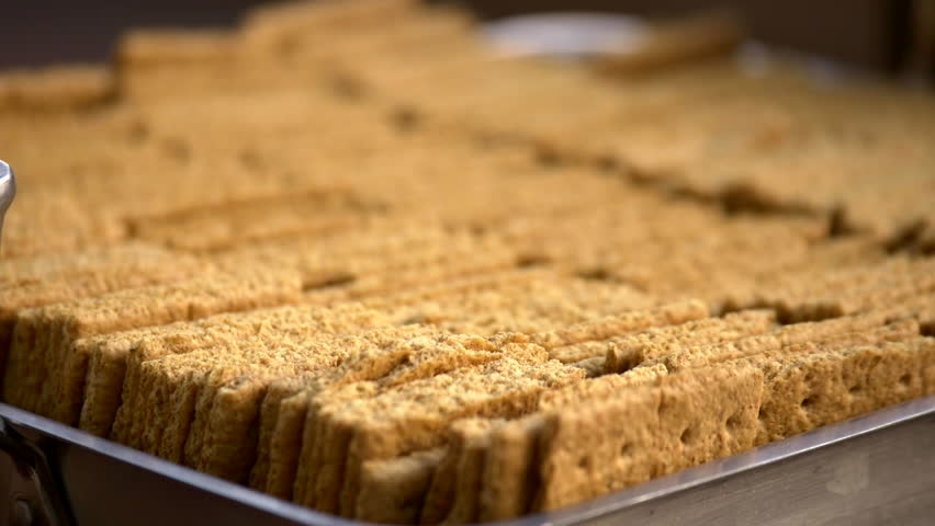 Close up of graham crackers in steel tray ready to make smores.