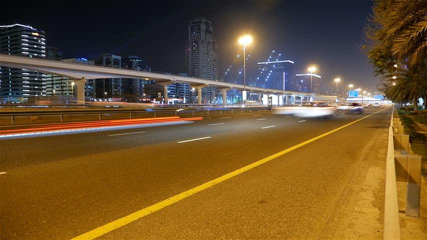 Night shot, time lapse of Dubai Street car traffic and metro station   Shutterstock HD Video #28076584