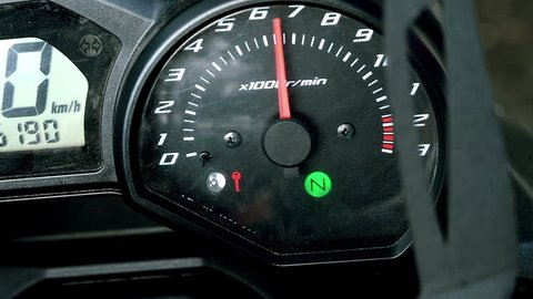 tachometer of sports bike in the process of starting the engine.