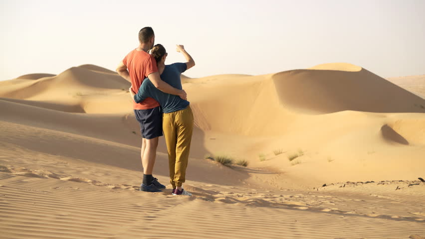 Young couple in love admire desert  | Shutterstock HD Video #28139914