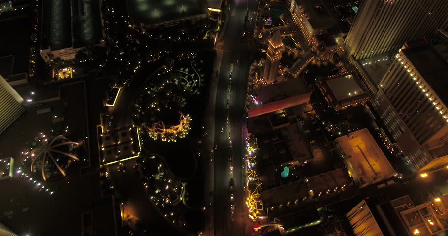Las Vegas Aerial v42 Flying over main strip blvd looking down vertically panning up at night 4/17 | Shutterstock HD Video #28142554