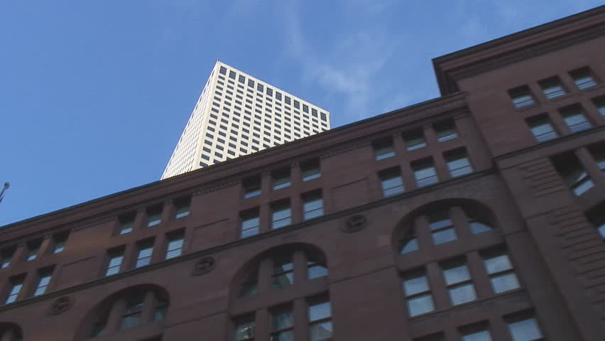 Multiple low angle tracking shots of Denver highrise office buildings