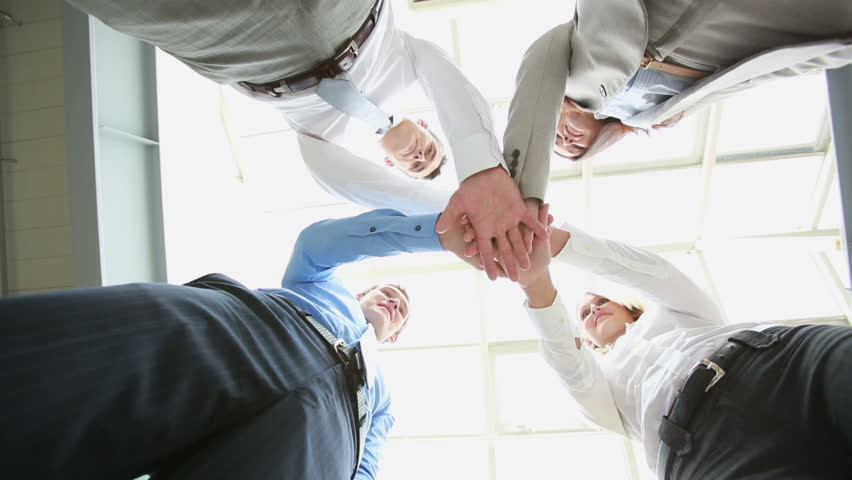 Conceptual video of business team putting their hands together as a sign of integrity and cooperation