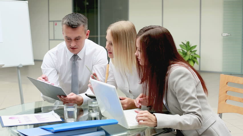 Experienced leader explaining the peculiarities of new strategy to his younger female associates | Shutterstock HD Video #2817304