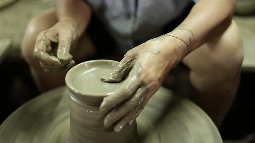 Woman hand molding clay pot plant. Pak Kret, Thailand. | Shutterstock HD Video #28174054