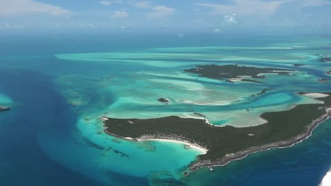 Exumas bahamas island chain, beautiful afternoon aerials of colorful water  and sand patterns nw view