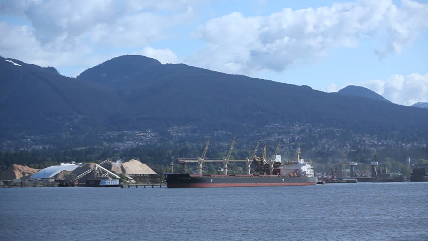 Discharging a shipment from a Cargo Freighter moored at Vancouver Habor