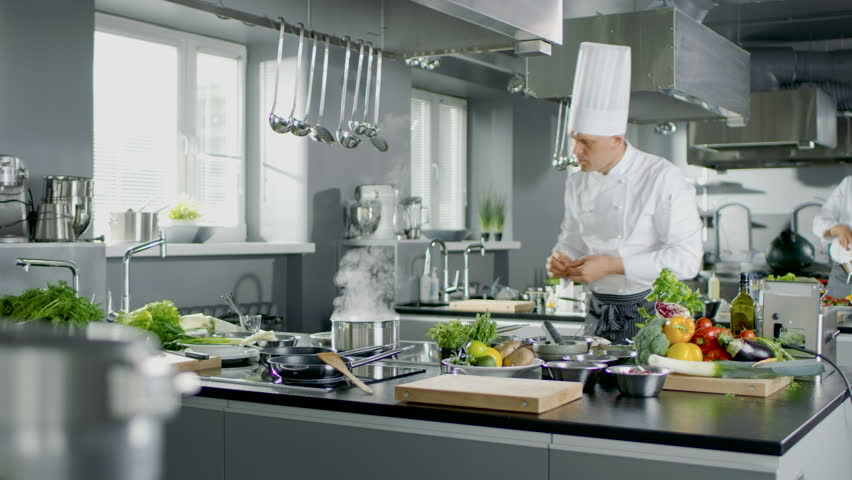 Restaurant Kitchen Chefs time lapse of a busy team of chefs preparing food in a commercial