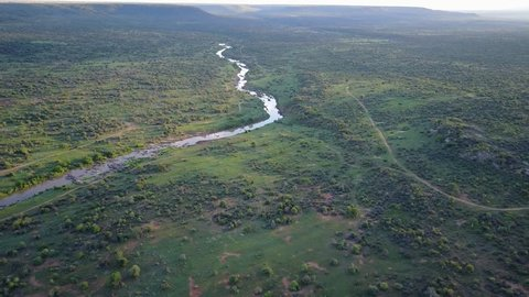 Aerial flight over unspoilt African wilderness and river