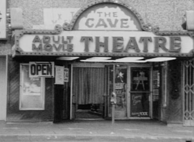 HOLLYWOOD, CALIFORNIA - OCTOBER 11:  Vintage editorial super 8 footage of The Cave XXX theater on Hollywood Blvd on October 11, 1988 in Hollywood California.