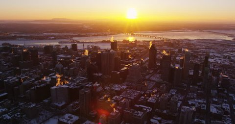 Aerial - Warm Sun Rises Above Cold City Skyline in Winter, Montreal,