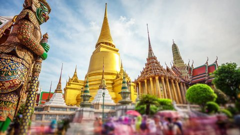 Golden stupa or chedi of Wat Phra Kaew also known as the Temple of the Emerald Buddha at the Grand Palace in Bangkok, Thailand (faces blurred for commercial use)