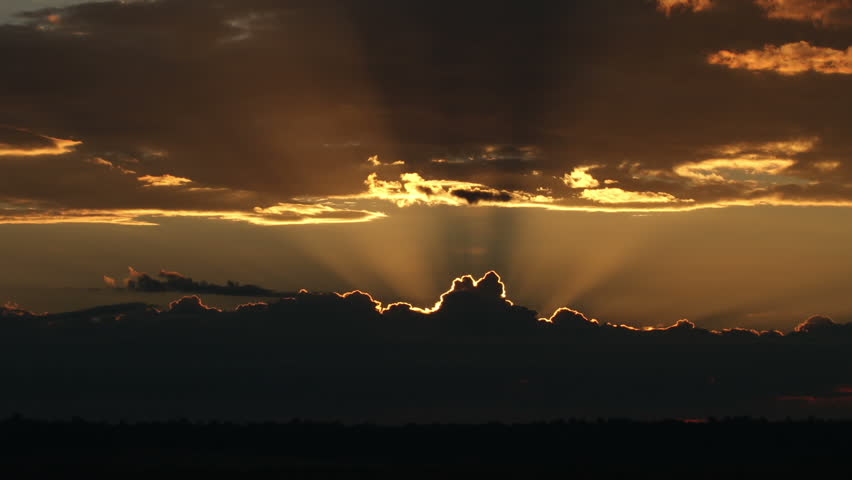 Spectacular sunrises over ominous thunderstorm on the horizon. HD 1080p time lapse. #2831713