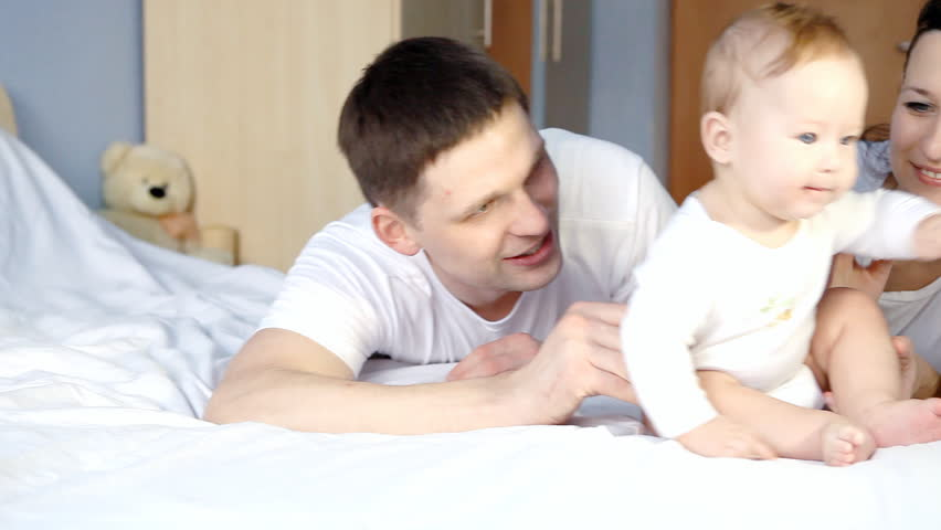 Hy Family Father Mother And Baby Playful In The Bedroom Hd Stock Footage
