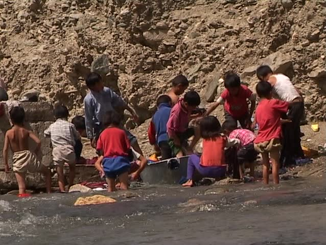 Child labor - laundering in the mountain river