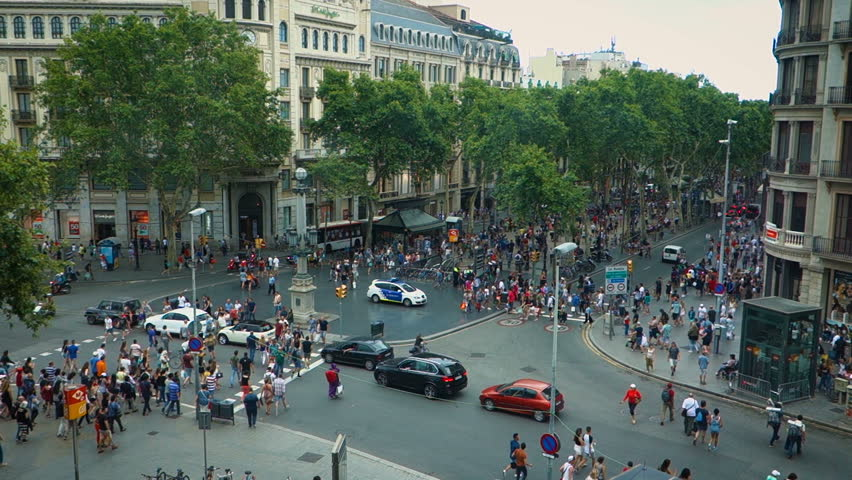 Famous street La Rambla where it meets Pelayo Street in Barcelona, Spain. View from above at 50 fps, . Thousands of people walk daily by this popular pedestrian area 1.2 kilometer long. | Shutterstock HD Video #28368004