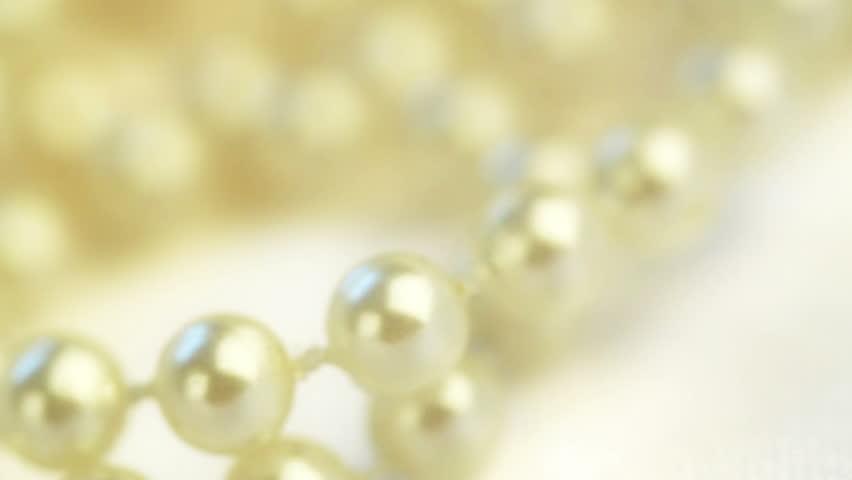 wedding background. beads on silk spinning closeup
