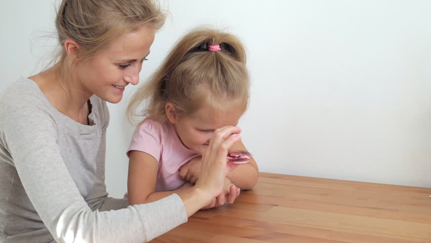 Daughter playing with hand spinner | Shutterstock HD Video #28375534