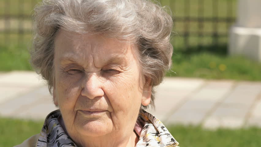 Portrait of serious mature old grandma, aged 80s, outdoors. Slow Motion. #28377034