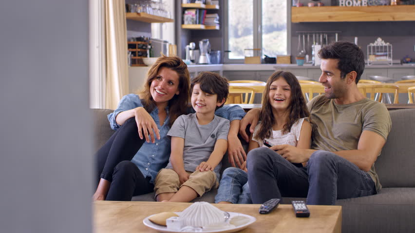 Family Sitting On Sofa In Open Plan Lounge Watching Television | Shutterstock HD Video #28384264