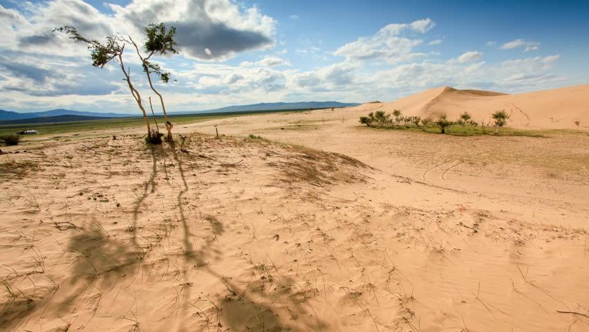 4K. Clouds over a dune in the Gobi Desert, Mongolia. Ultra HD, 4096x2304