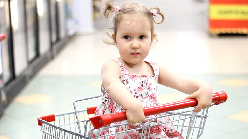 The child in the supermarket is sitting in a cart for food | Shutterstock HD Video #28390774