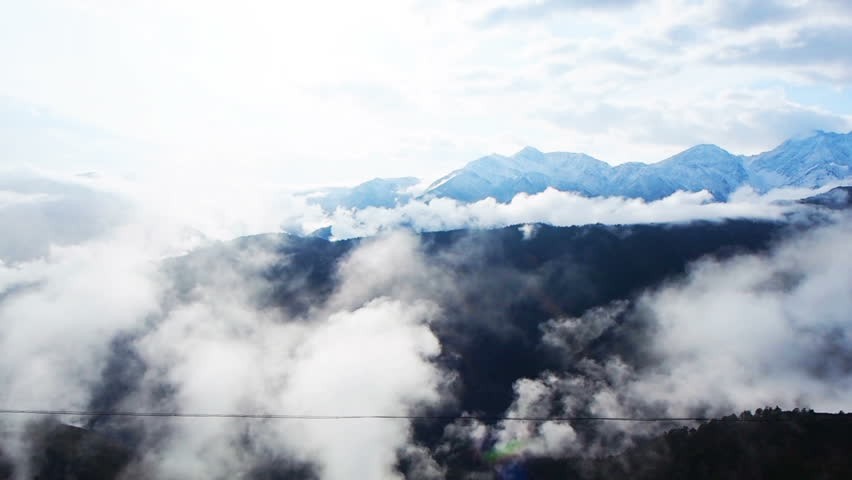 View of fog flowing on the high mountain in Sichuan, China | Shutterstock HD Video #28392358