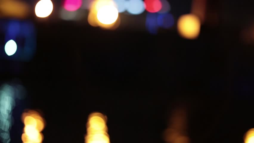 Bokeh from river bus floating on the waves at night. | Shutterstock HD Video #28402954