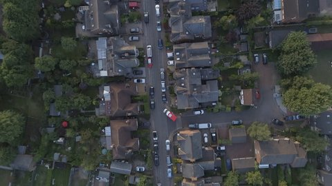Bird's Eye View of the Streets, Houses and Gardens of a Typical English Town at Sunset