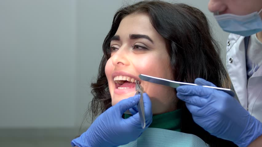 Dentist Installing Teeth Braces  Hands Stock Footage Video (100%  Royalty-free) 28443724 | Shutterstock