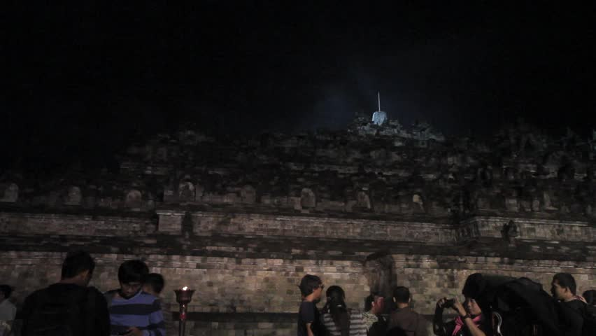 MAGELANG, INDONESIA - CIRCA MAY 2012: People visit Borobudur Temple to worship during the annual Buddhist holy day of Vesak circa May 2012 in Magelang, Indonesia.