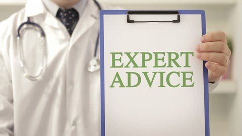 Doctor with expert advice sign