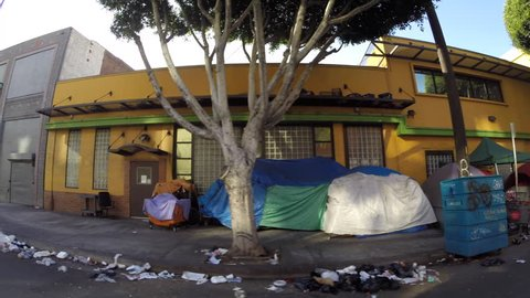 Los Angeles, California, USA - July 4, 2017:  Homeless tents along gritty San Pedro Street in the Skid Row district.