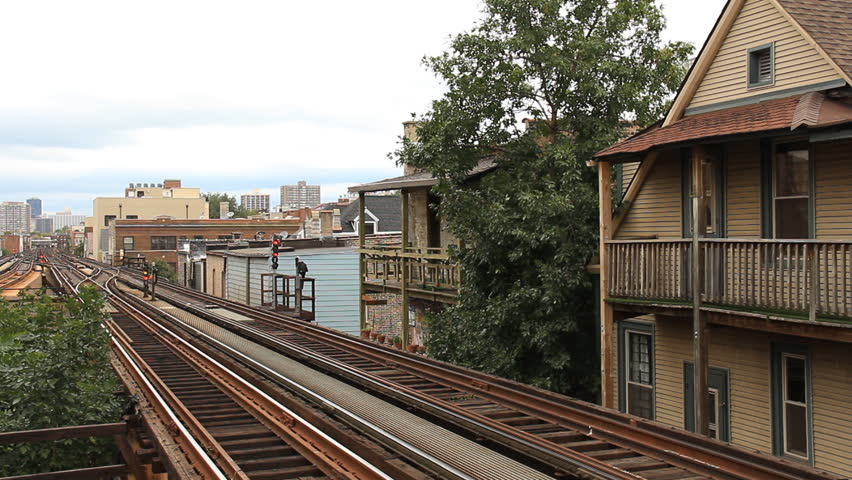 Chicago L Train. Chicago elevated rail passing closely to apartments near the